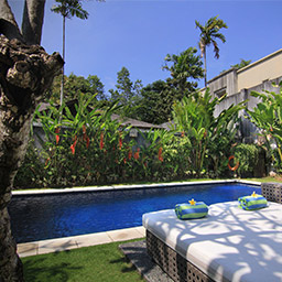 Nothing makes happier than lying on day bed at poolside and enjoy the tranquility of lush garden surrounding under Bali sun.