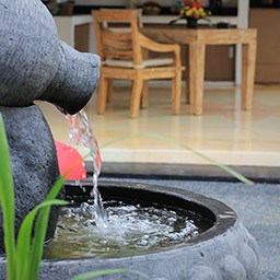 A serene ambience by the rustling fountain at villa garden simply soothes anyone that hearing it down.