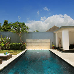 Gazebo, sun chairs, and huge pool at a private garden space are inviting you to enjoy a tropical pool day in this villa.