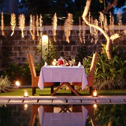 Having a romantic candle light dinner surrounded by a peaceful night ambiance is a must honeymoon activity to do in Bali.