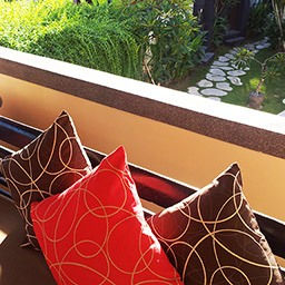 Sitting on this comfy sofa and allowing fresh breezy air includes garden view making a contact with you is the art of waiting in our lobby.